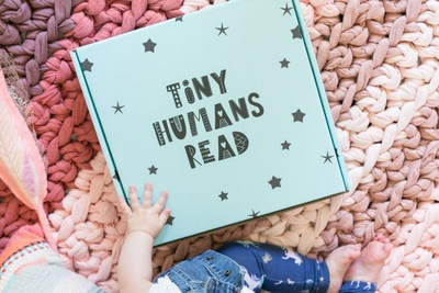 Tiny Humans Read Photo 1