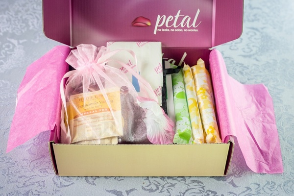 my Petal Club box open to show tampons, pads, and tea.