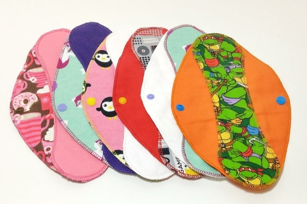 reusable panty liners made from cotton flannel with a variety of colors and patterns.