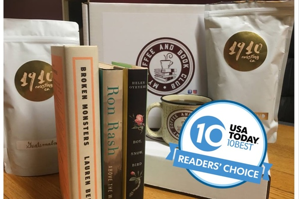 A My Coffee and Book Club subscription box with 2 bags of coffee grounds, a mug and 3 books around it.